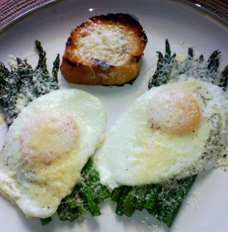 fried eggs over asparagus with parmesan and grilled baguette
