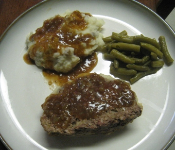 meatloaf and onion gravy with mashed red potatoes and green beans
