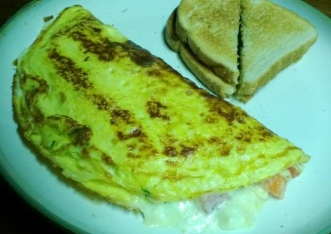 omelette- with chives, romano, parmesan, roma tomato and italian seasoning