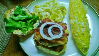 grilled bacon cheese burger with manchego aioli grilled sweet corn and macaroni salad