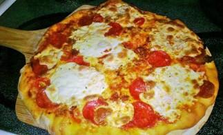 sausage, pepperoni and tomato pizza