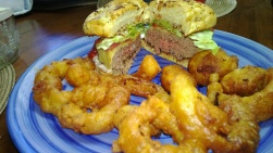 grilled pepper-jack burger with homemade onion rings and fried mushrooms