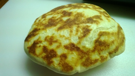 puffed up naan right out of the oven