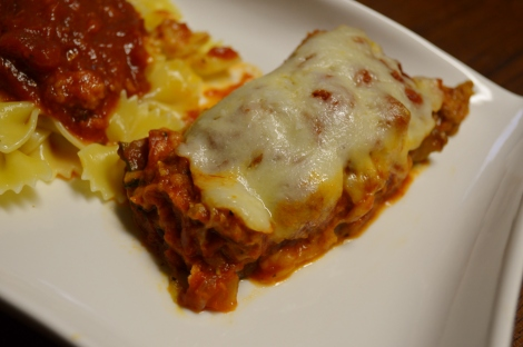I know this looks like lasagna (and it tasted a lot like it) but this is zucchini fresh from the garden, stuffed with Italian sausage! Smothered in cheese and swimming in a good tomato sauce, naturally.